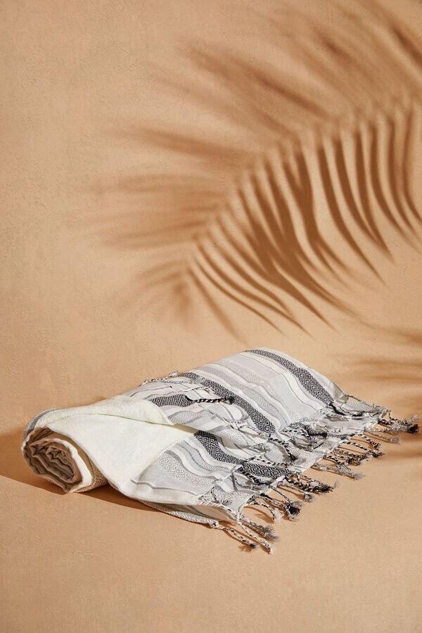 Toalha de praia às riscas da women'secret
